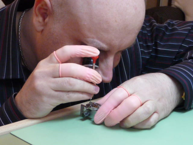 THE WATCHMAKER AT THE BENCH WATCHMAKING AND REPAIRING WATCHES, POCKET WATCHES, QUARTZ WATCHES